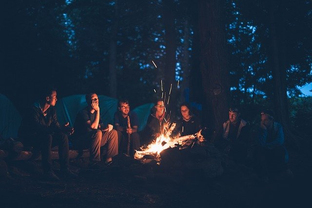 A group of people standing around a fire